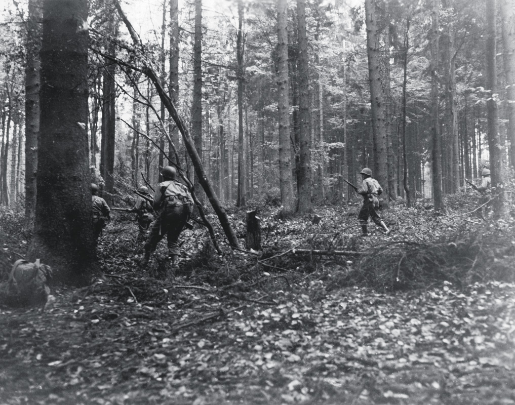 28th Infantry Division troops advance through the Hürtgen Forest