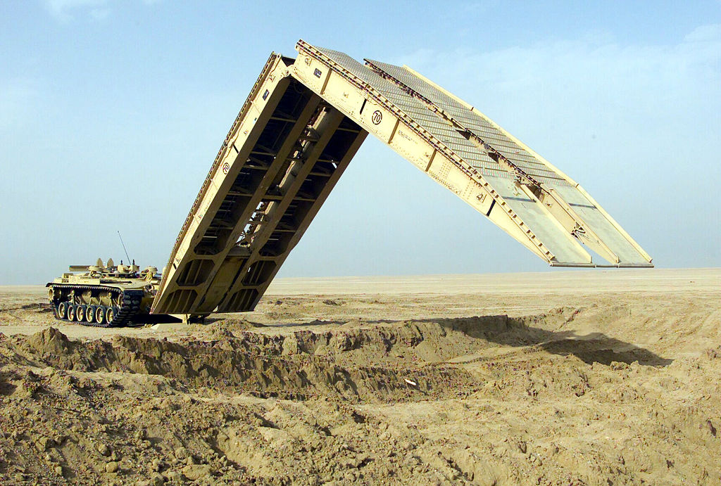 M60A1 Armored Vehicle Landing Bridge; Camp Coyote, Kuwait; An M60A1 Armored Vehicle Landing Bridge (AVLB) practices the deployment of its 60 foot bridge span, designed to quickly move heavy military wheeled and tracked vehicles over unstable or hazardous terrain.
